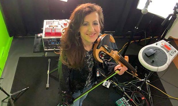 Caryn Lin Holding an Electric Violin
