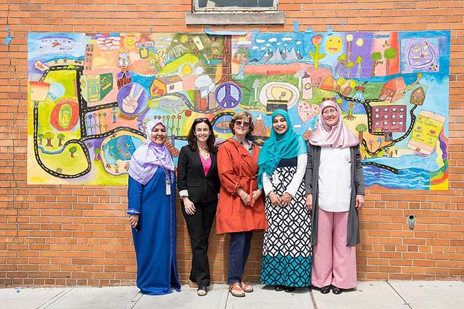 Image of Principal Saima Sanaullah; Jacqueline Knox, Arts Education Program manager at Young Audiences Arts for Learning New Jersey & Eastern Pennsylvania; teaching artist Kit Sailer; Vice Principal Eman Elkholy; and Faatimah Yanes, administrator at Miftaahul Uloom Academy.