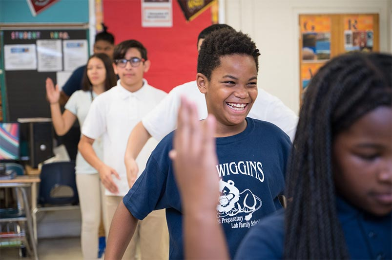 Students at US Wiggins College Preparatory Lab Family School rehearse their step routine with teaching artist Maxine Lyle.