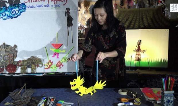 Hua Hua Zhang demonstrating shadow puppetry