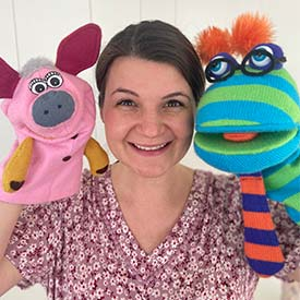 Renata Townsend with 2 colorful hand puppets