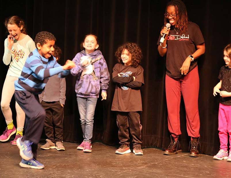 Quynn Johson from SOLE Defined teaching students to tap dance